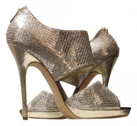 Preload https://item3.tradesy.com/images/jimmy-choo-champagne-glitter-private-247-collection-pumps-size-us-75-162842-0-0.jpg?width=440&height=440