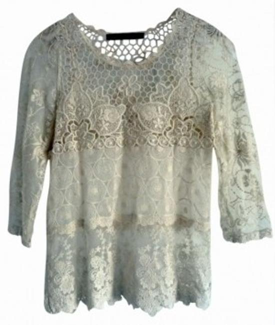 Preload https://item3.tradesy.com/images/zara-ivory-night-out-top-size-8-m-162852-0-0.jpg?width=400&height=650