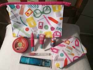 Clinique Brand new Clinique bundle includes, 1 Large cosmetic bag, 1 small cosmetic bag, 1 Clinique Cherry Chubby stick for lips, other lip products and body cream.