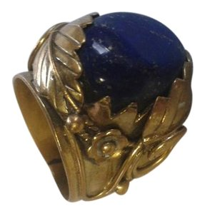 Other brassy metal ring with dark blue stone