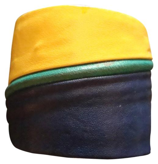 Preload https://item5.tradesy.com/images/yellow-blue-and-green-vintage-metal-cuff-wrapped-in-leather-bracelet-1631054-0-0.jpg?width=440&height=440