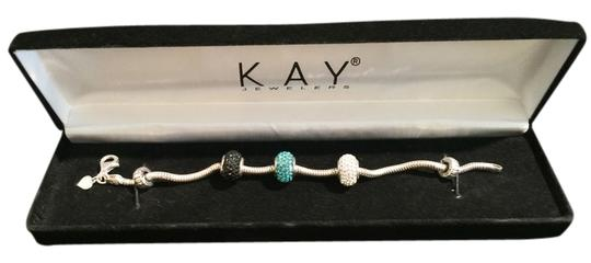 Preload https://item5.tradesy.com/images/kay-jewelers-sterling-silver-charm-bracelet-with-swarovski-charms-and-stoppers-1631249-0-0.jpg?width=440&height=440