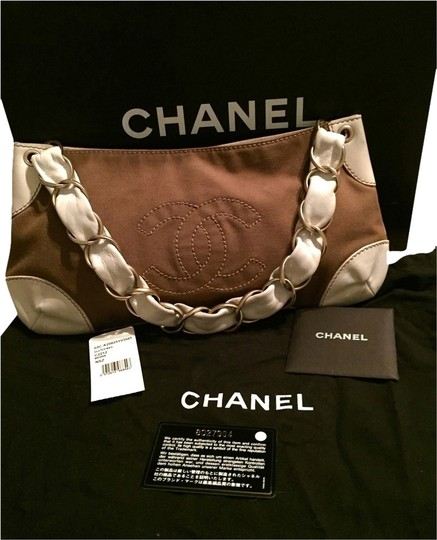 Preload https://item2.tradesy.com/images/chanel-army-brown-leather-accents-wcanvas-body-shoulder-bag-1631426-0-0.jpg?width=440&height=440