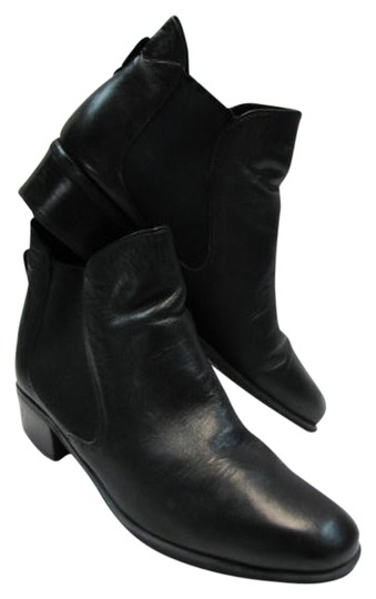 Preload https://item3.tradesy.com/images/naturalizer-black-leather-bootsbooties-size-us-95-narrow-aa-n-1634042-0-0.jpg?width=440&height=440