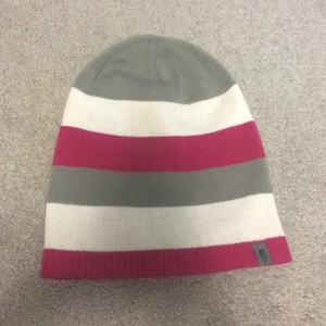 The North Face One side is dark pink; other side Is Pink, Grey And White Striped.