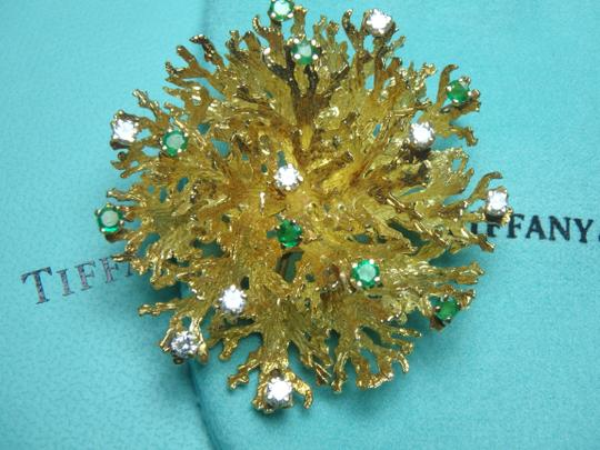 Tiffany & Co. Rare 18k yellow gold coral brooch/pendant, with diamonds and emeralds