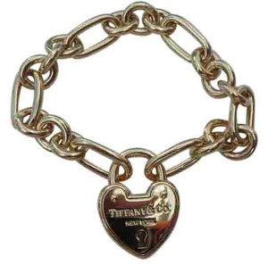 Tiffany & Co. New Tiffany & Co 18k yellow gold heart lock charm bracelet 56 grams w/ boxes 7