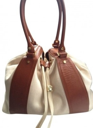 Preload https://item2.tradesy.com/images/tory-burch-gwendolyn-bucket-tote-cognac-and-cream-leather-canvas-hobo-bag-16391-0-0.jpg?width=440&height=440