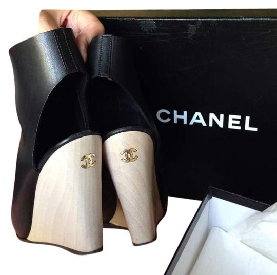 Preload https://item3.tradesy.com/images/chanel-black-leather-wedges-size-us-75-163952-0-1.jpg?width=440&height=440