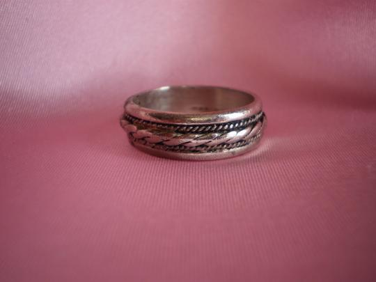 Preload https://item1.tradesy.com/images/silver-band-ring-164050-0-0.jpg?width=440&height=440