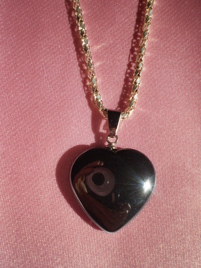 Preload https://img-static.tradesy.com/item/164094/new-steel-heart-necklace-0-0-540-540.jpg