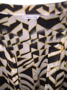 Trina Turk short dress Black White Gold Cover-up Swim Patterned Tunic on Tradesy
