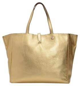 Juicy Couture Tote in Gold with Reversed Side Snake Print