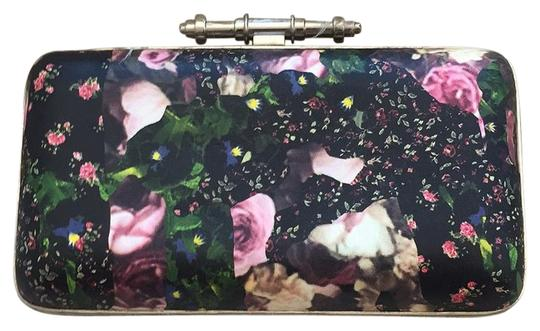 Preload https://img-static.tradesy.com/item/16450474/givenchy-obsedia-in-printed-leather-black-clutch-0-1-540-540.jpg