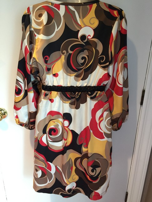 RipeLimited short dress rust, yellows, browns, golds, white on Tradesy