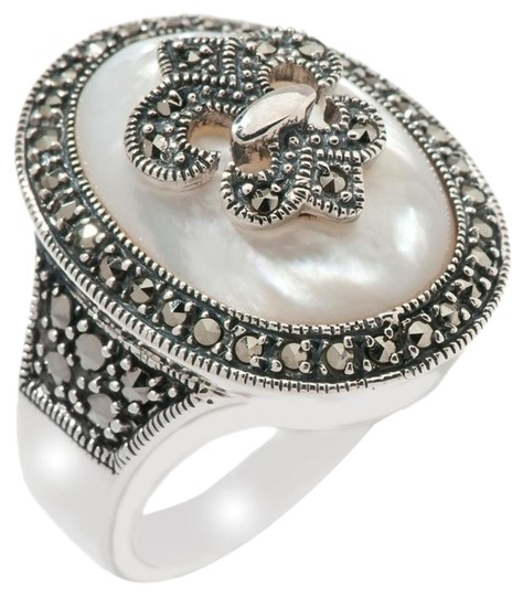 Preload https://img-static.tradesy.com/item/16455208/mother-of-pearl-and-marcasite-sterling-silver-size-5-ring-0-1-540-540.jpg