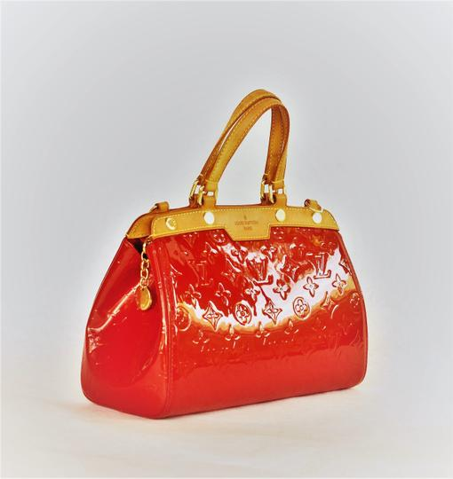 Louis Vuitton Patent Leather Leather Satchel in burgundy