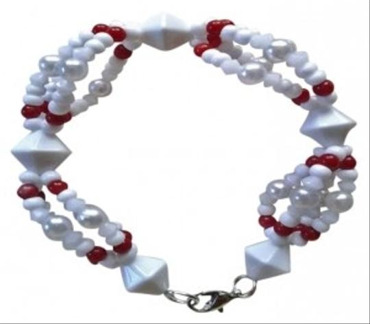 Preload https://item2.tradesy.com/images/white-with-red-afro-cuban-yoruba-style-obbatala-ochagrinan-style-bracelet-164696-0-0.jpg?width=440&height=440