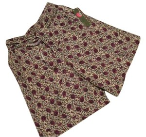 Outback Red Skort deep red/peacock blue/olive green on a khaki tan background