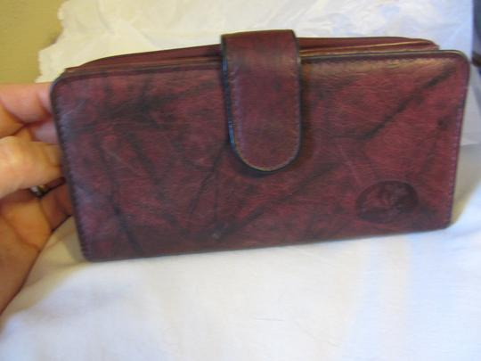 Other Lillies & Leather ...Rich maroon marble & Gorgeous Leather throughout!