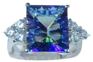 Attractive Emerald Shape 12x10mm Mystic Blue Quartz In a basket Ring setting