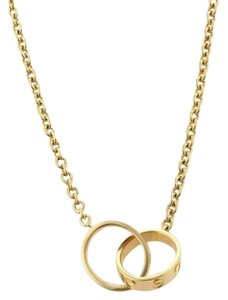 Cartier gold love rings up to 70 off at tradesy cartier cartier love infinity double ring pendant necklace in 18k yellow gold aloadofball Choice Image