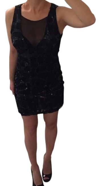 Preload https://item1.tradesy.com/images/bebe-black-above-knee-night-out-dress-size-0-xs-1650375-0-0.jpg?width=400&height=650