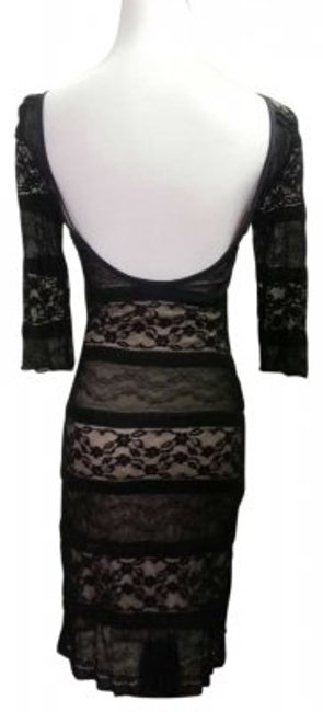 Preload https://item2.tradesy.com/images/black-lace-sexy-knee-length-cocktail-dress-size-2-xs-165376-0-0.jpg?width=400&height=650