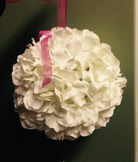 White hydrangea with pink ribbon flower ball reception