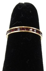 Goldtone Red Stones Channel Set Eternity Band Ring Bj14