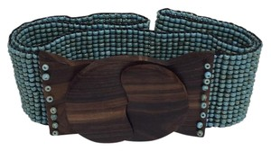 Turquoise hand beaded belt with wooden closure.