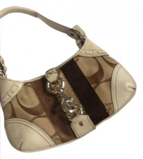 Preload https://item4.tradesy.com/images/coach-hamptons-tan-cloth-and-leather-clutch-166243-0-0.jpg?width=440&height=440