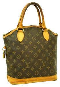 Louis Vuitton Lock It Satchel in Brown
