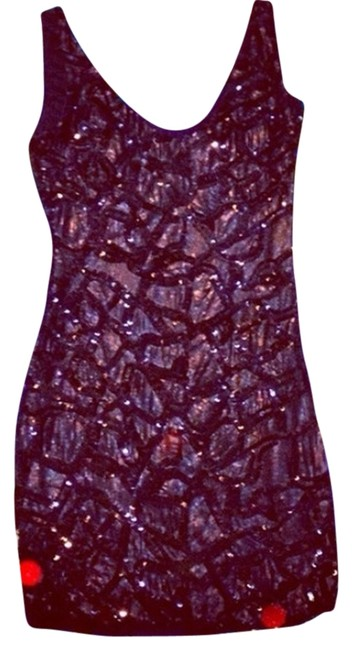 Preload https://item3.tradesy.com/images/bebe-black-sequined-mini-cocktail-dress-size-0-xs-1665507-0-0.jpg?width=400&height=650