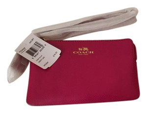 Coach Wristlet in reddish pink