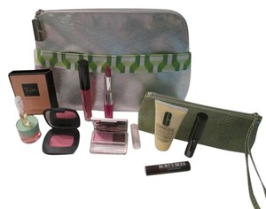 Clinique 12pc. Big Summer Sale! Clinique Goodies include: ( 1 ) Clinique Large cosmetic bag, Silver and green and white trim front pocket. 1 Small cosmetic bag/coin purse, green color. Makeup, skincare, and sample tube fragrance!
