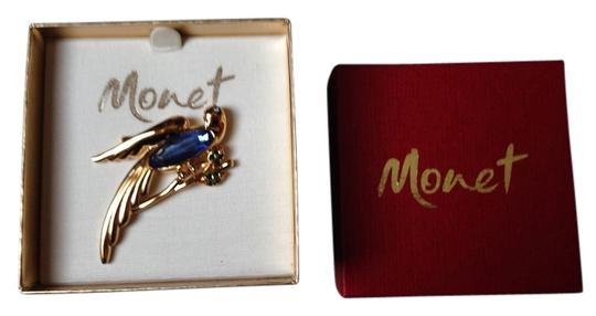 Preload https://item2.tradesy.com/images/monet-gold-tone-with-blue-sapphire-stones-brooch--1668916-0-0.jpg?width=440&height=440