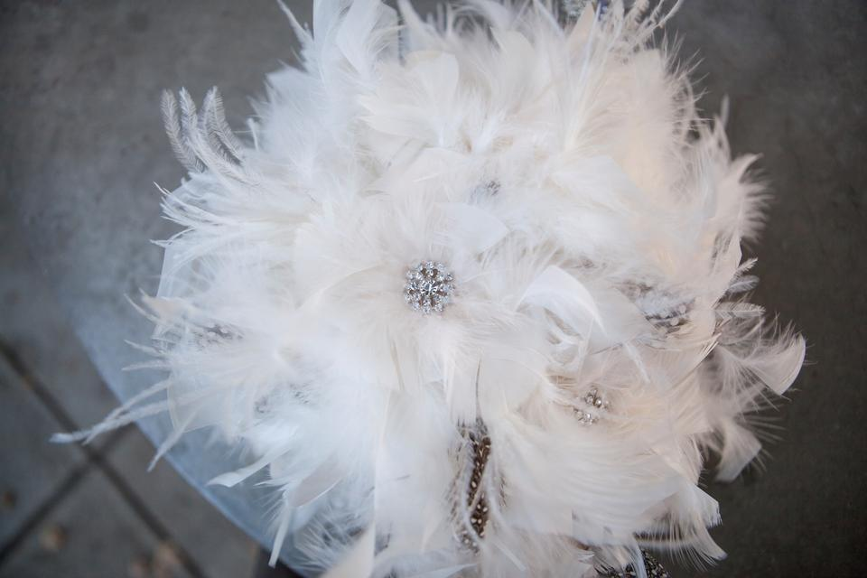 White Feather Bridal Bouquet And Six Bridesmaids Black And