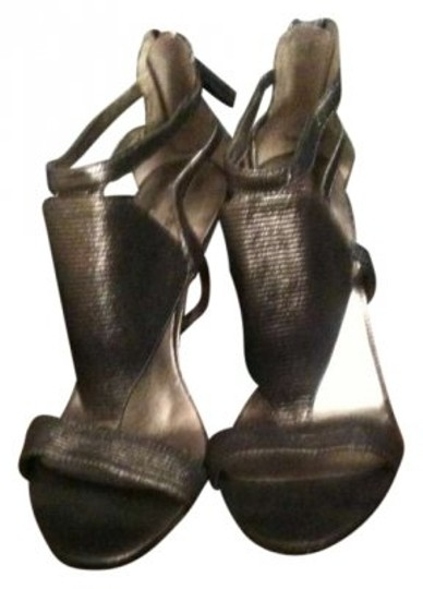 Preload https://item1.tradesy.com/images/nine-west-pewter-silver-sandals-size-us-8-167255-0-0.jpg?width=440&height=440