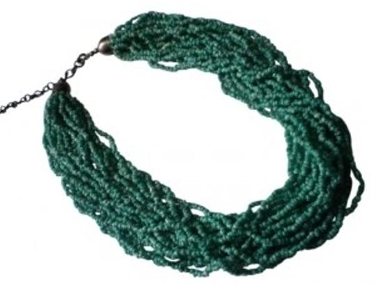 Preload https://item1.tradesy.com/images/multi-strand-green-and-white-seed-beads-necklace-167265-0-0.jpg?width=440&height=440