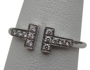Tiffany & Co. Tiffany T Wire Diamond Ring size 8 with both tiffany box, in like new condition.