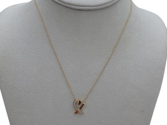 Preload https://img-static.tradesy.com/item/16737451/tiffany-and-co-yellow-gold-and-diamonds-paloma-picasso-loving-hear-pendant-with-in-18k-necklace-0-1-540-540.jpg