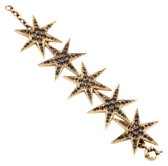 Preload https://img-static.tradesy.com/item/16738468/gray-crystals-and-gold-tone-sparkly-star-826-bracelet-0-1-540-540.jpg