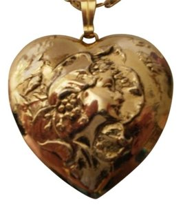 Preload https://item2.tradesy.com/images/like-new-goldtone-fairy-profile-heart-necklace-167396-0-0.jpg?width=440&height=440