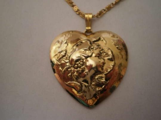 Unknown Like New Goldtone fairy profile heart necklace