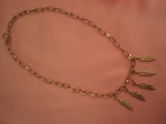 Other Silvertone feathers necklace