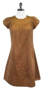 Calypso short dress Copper Cap Sleeve Silk on Tradesy