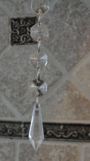 Preload https://img-static.tradesy.com/item/167602/clear-5-inch-hanging-icicles-only-cents-each-reception-decoration-0-0-540-540.jpg