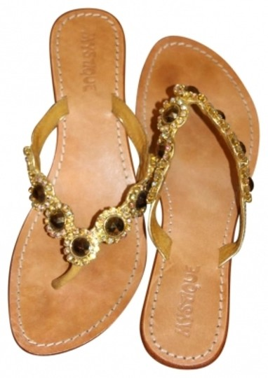 Preload https://item1.tradesy.com/images/tan-with-jewels-sandals-size-us-9-167650-0-0.jpg?width=440&height=440