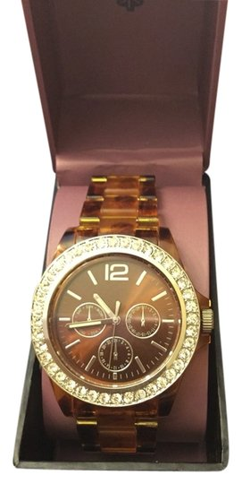 Preload https://item4.tradesy.com/images/watch-with-tortoise-band-and-rhinestone-dial-1679563-0-0.jpg?width=440&height=440